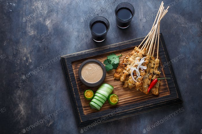 Sate Ayam -  Is a dish of seasoned, skewered and grilled meat. Top view copyspace