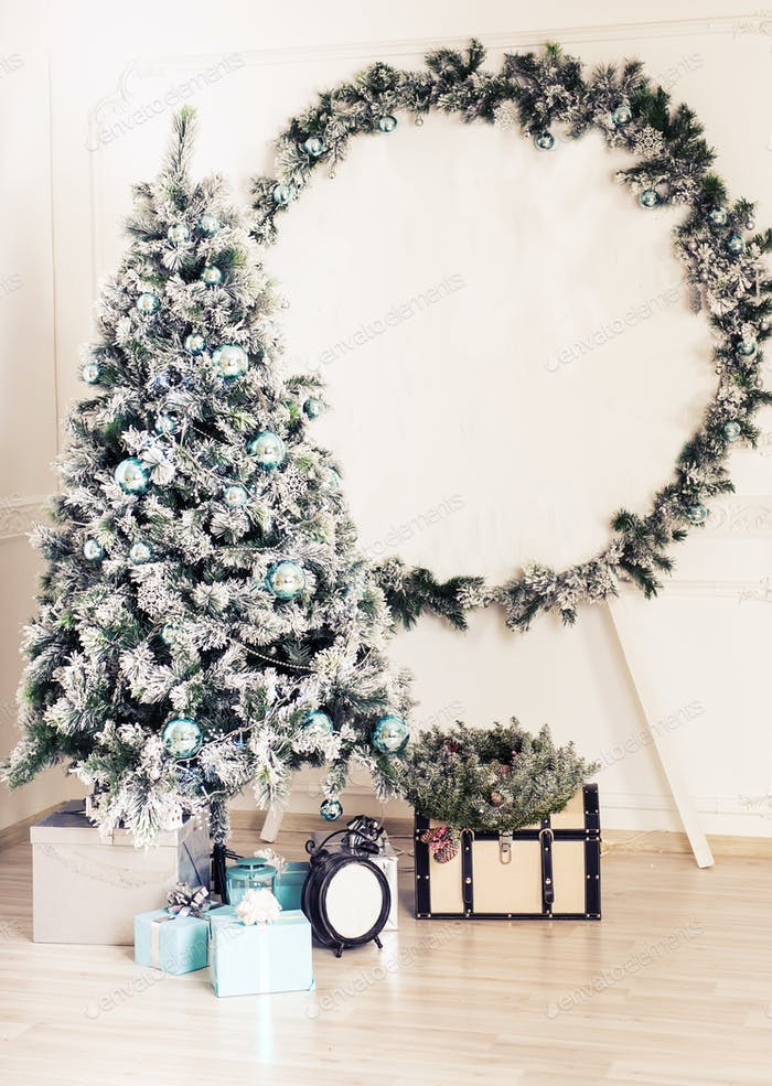 Decorated fir tree and gift boxes in living room