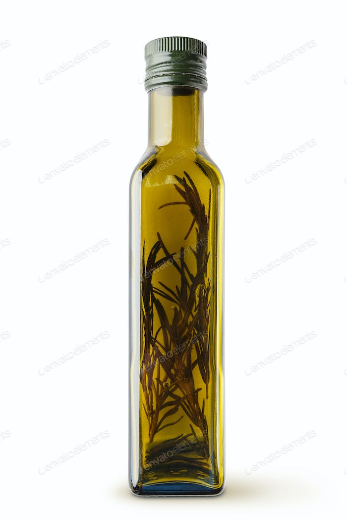 Bottle with olive oil on white