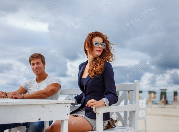 Redhead woman and one guy.