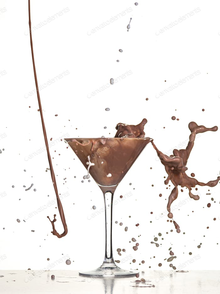 macro shoot with hot chocolate falling in glass on white in studio