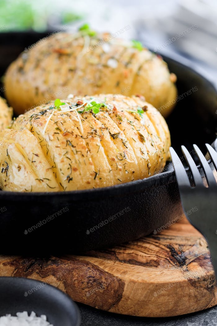 Close-up of homemade baked potato with olive oil