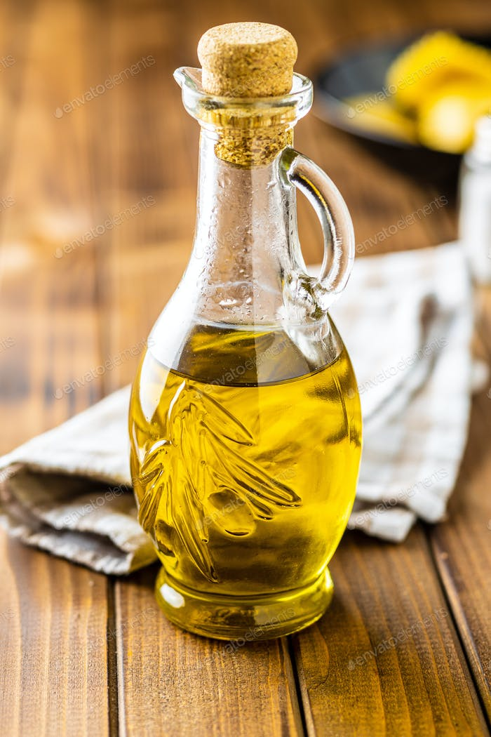 Olive oil in glass bottle.