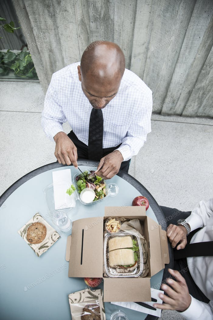 Looking down on a black businessman having lunch with a business associate.
