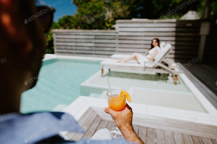 couple relax on beach resort villa