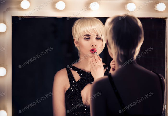 Beautiful Blonde Woman Apply Red Lipstick Looking Into Mirror