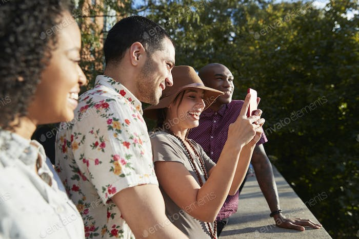 Group Of Tourists Taking Photos On Mobile Phones