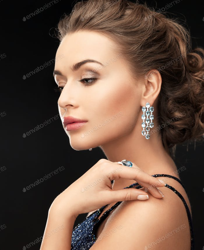 woman with earrings and ring