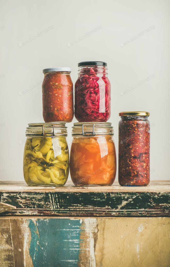 Autumn preserved pickled or fermented colorful vegetables in jars