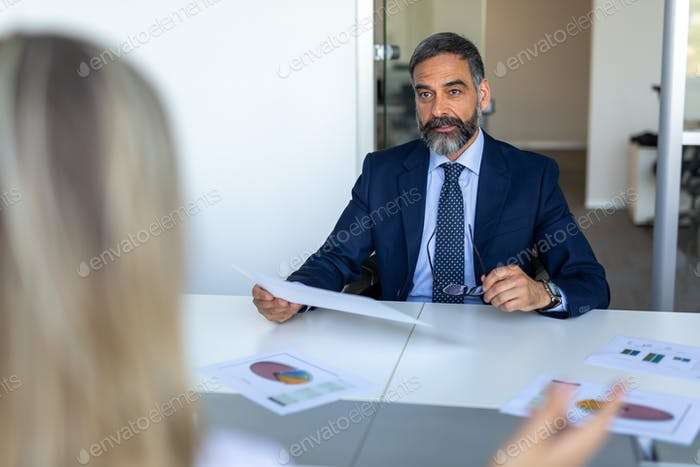 Elegant mature businessman analyzing data in office