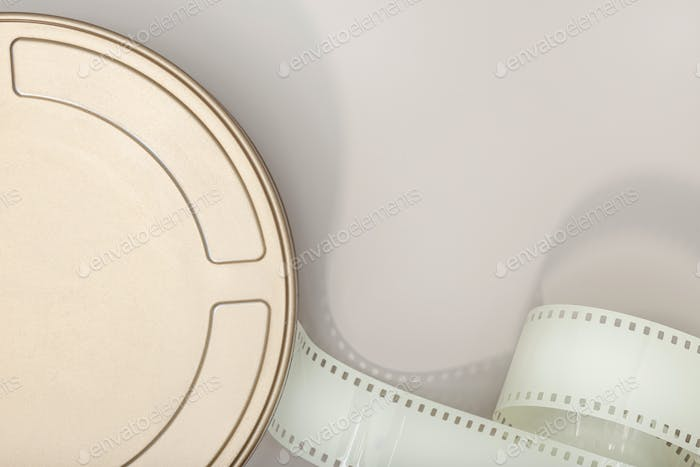 Motion Picture Film Can and film strip on table