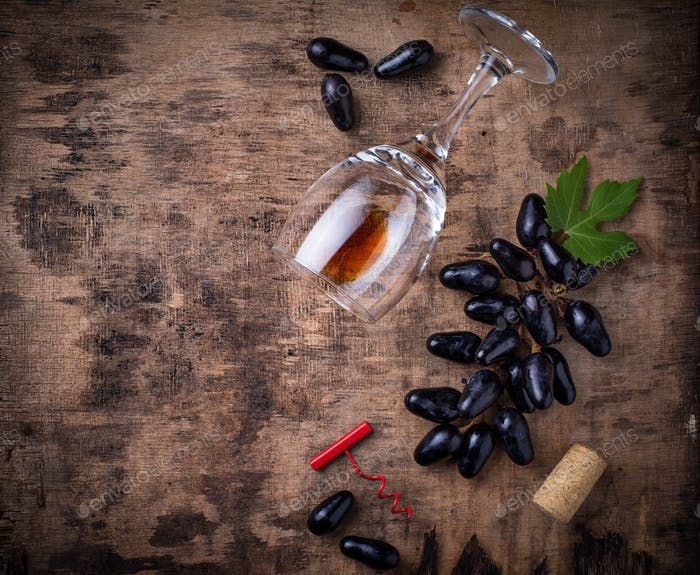 Grapes, red wine, glass, corkscrews and cork