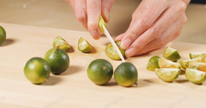 Cutting Citrus on wooden cutting pad
