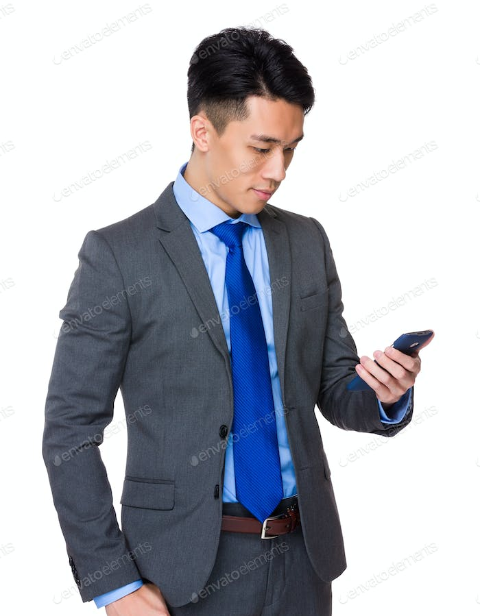 Young businessman read on the cellphone