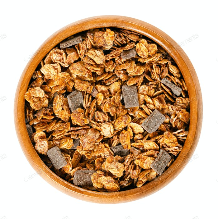 Crunchy chocolate granola in wooden bowl