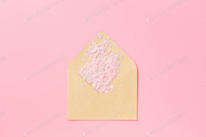Flat Lay of Envelope With Pink Confetti for Valentine's Day
