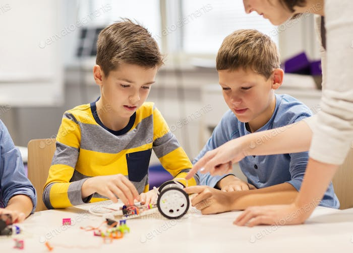 happy children building robot at robotics school