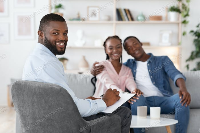 Family Psychotherapy. Happy Black Spouses And Marital Counselor Posing After Successful Therapy