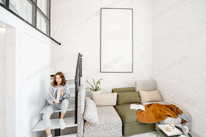 Living room with blurred human figure