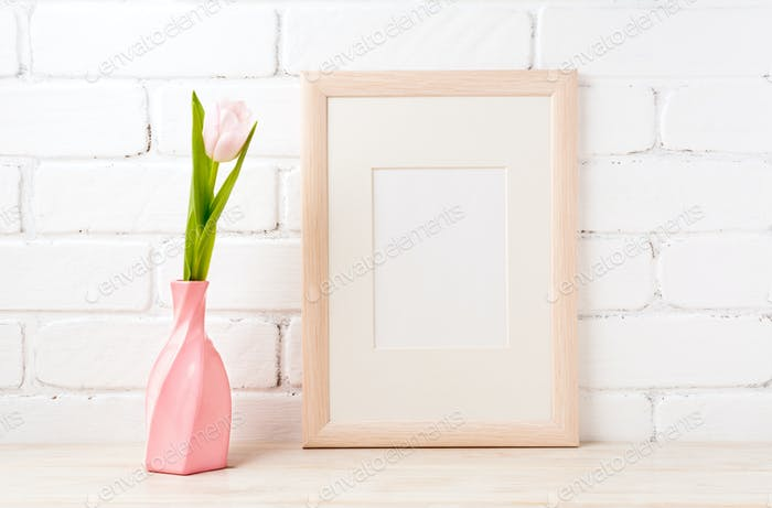 Wooden frame mockup with pink tulip in swirled vase