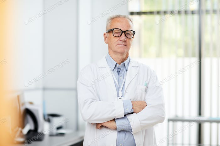 Senior Doctor Posing in Clinic