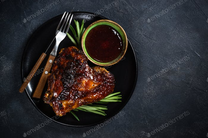 Baked turkey thigh with cranberry sauce and herbs