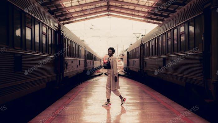 Black woman in train station depot