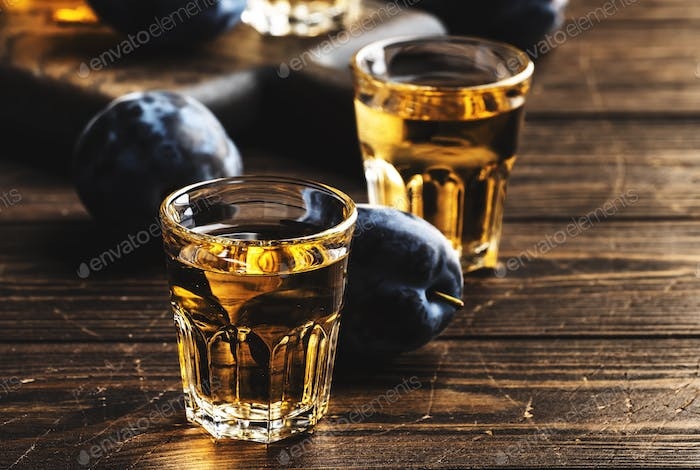 Slivovica - plum brandy or plum vodka, Balkan hard liquor, strong drink in shot glasses