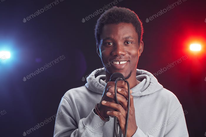 Smiling African-American Man Holding Microphone