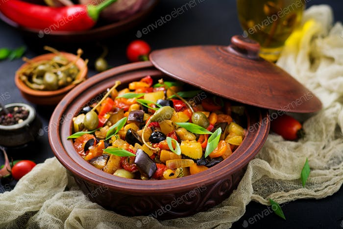 Hot spicy stew (caponata) eggplant, zucchini, sweet pepper, tomato, carrot, onion, olives and capers
