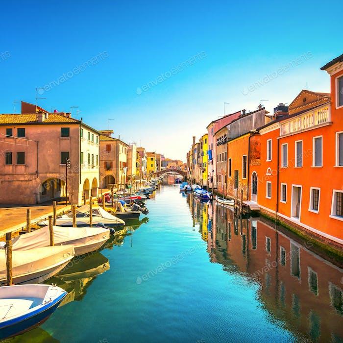 Chioggia town in venetian lagoon, water canal and church. Veneto