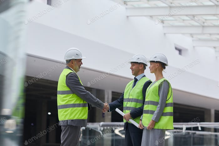 Business Deal at Construction Site