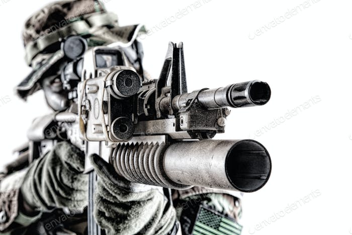 Aiming commando shooter isolated studio portrait