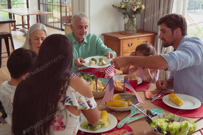 High view of multi-generation Caucasian family having food together on dining table at home