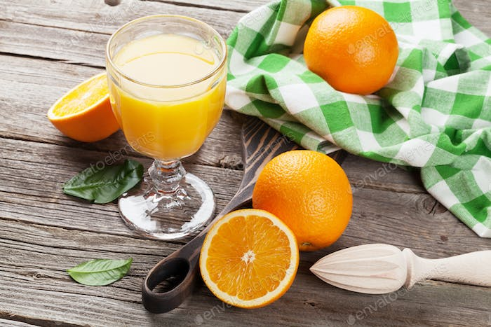Fresh ripe oranges and juice