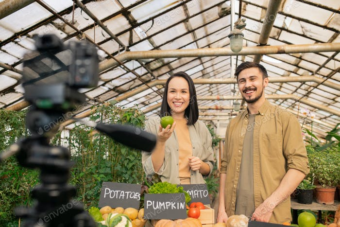 Young couple telling about benefit of organic food