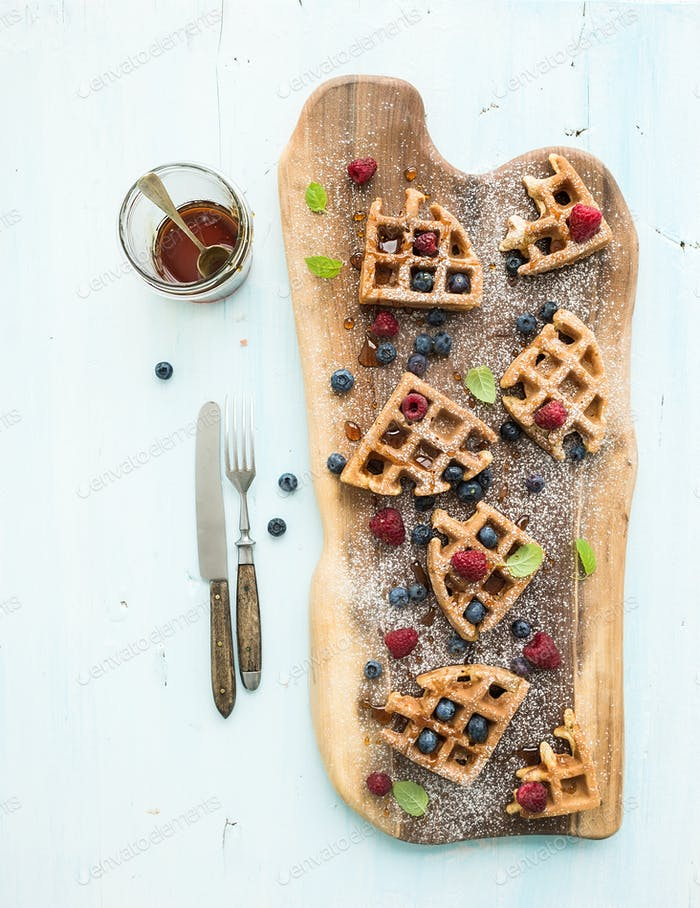 Soft Belgian waffles with berries, honey and mint