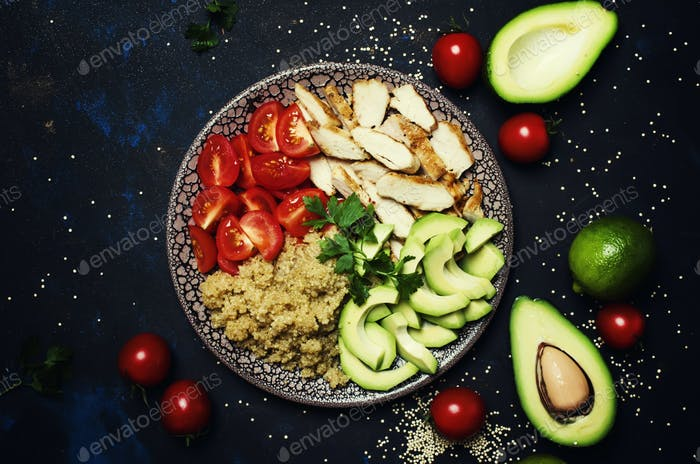 Healthy food, avocado, quinoa, chicken and tomatoes