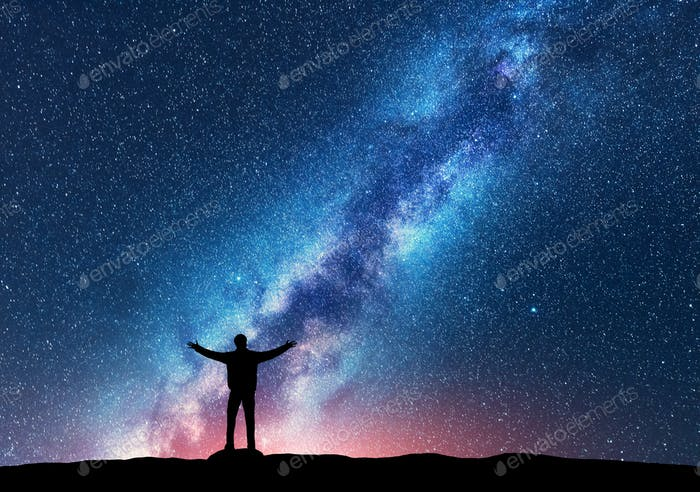 Space. Milky Way with silhouette of a happy man