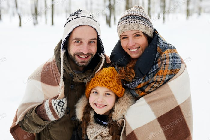 Happy Family Posing in Winter Forest