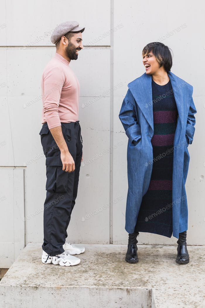 Indian couple posing in an urban context