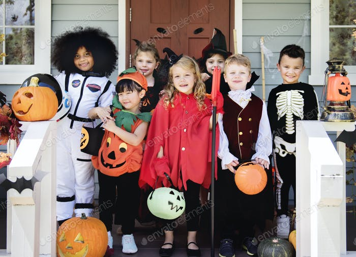 Little children in Halloween costumes