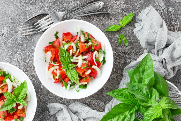 Vegetable salad with fresh tomato, basil and onion