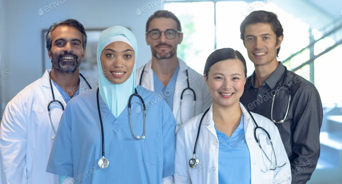 Portrait of happy diverse medical team of doctors looking at camera in the hospital