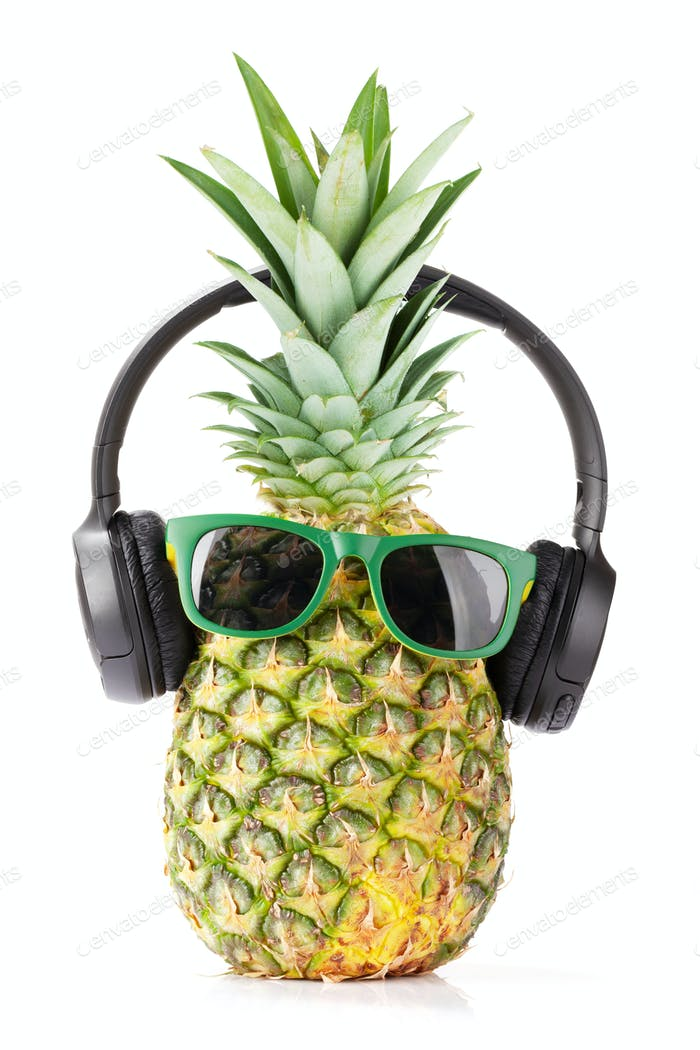 Ripe pineapple with sunglasses and headphones