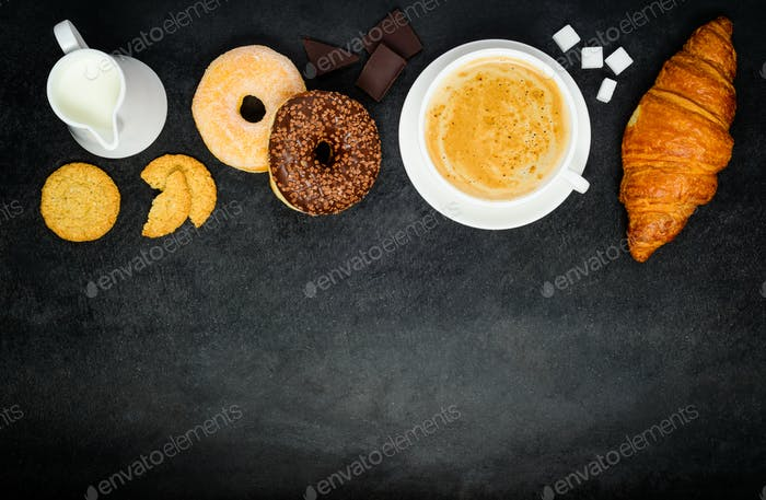 Cappuccino Coffee with Donut and Croissant on Copy Space Area
