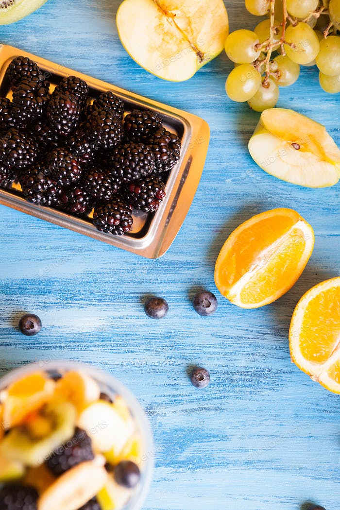 Top view of fresh mix of delicious fruits on wooden table