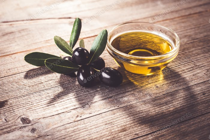 Olive oil with leaves and olives