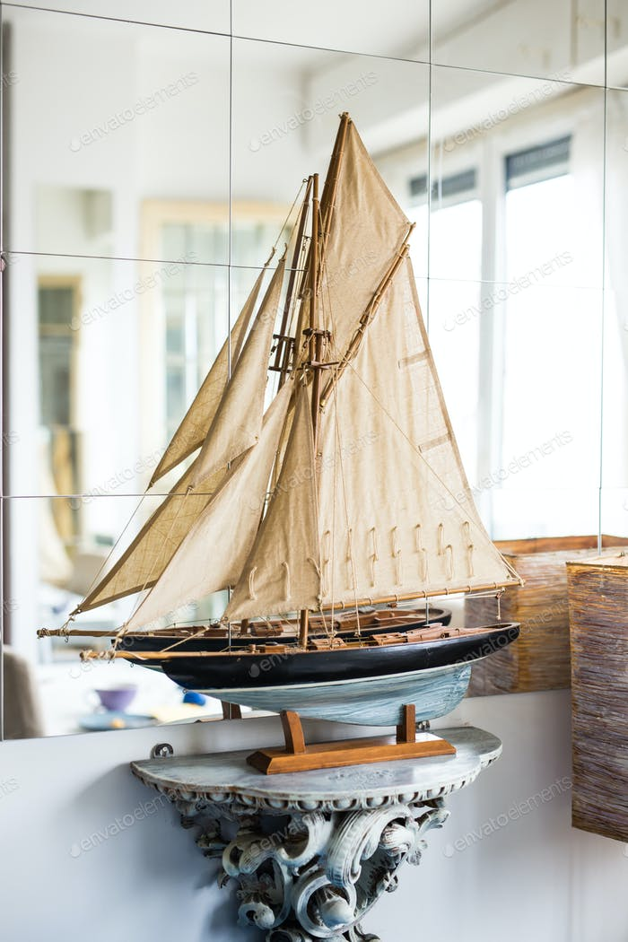 Hobby, interior and collecting concept - The layout of a sailboat in the room