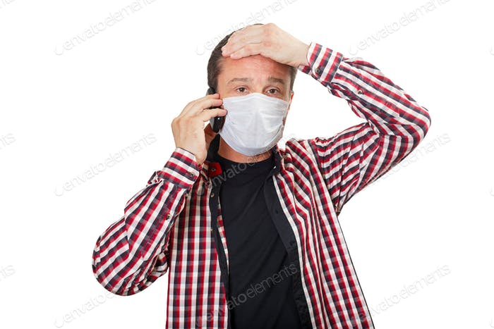 Sick man in a medical mask calls a doctor
